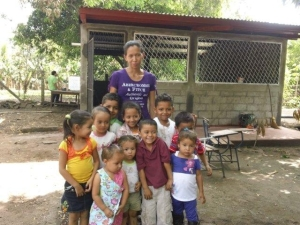 Brenda and children outside school